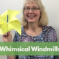 Photo of Mrs. Charles holding a yellow pinwheel she made. She is standing in front of a beige wall.