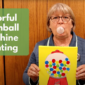 Photo of Rose blowing a bubble with gum while holding her gumball machine painting.